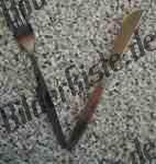 Messer und Gabel in V-Form
